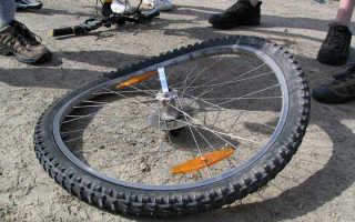 Как исправить восьмерку на колесе велосипеда?